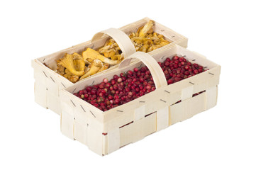 cranberries and golden chanterelle  in wooden boxes