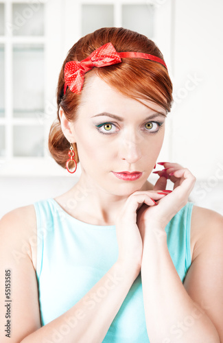Portrait of stylish beautiful woman with red hair