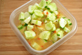 Sliced Cucumber Salad in a Plastic Lunch Bowl