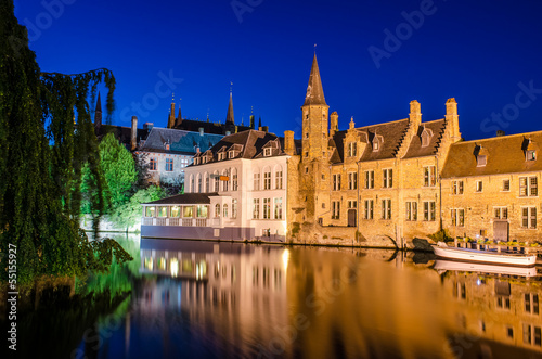 Bruges canal at night and medieval houses with reflection in wat