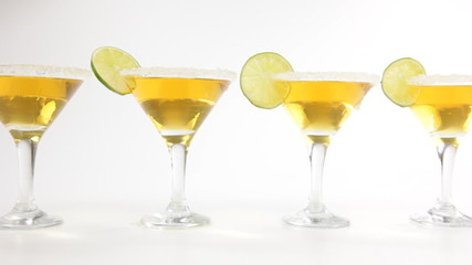 Martini cocktails with lime on white background