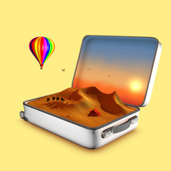 Opened suitcase that invitates to visit dunes