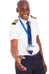 friendly african pilot handshake gesture