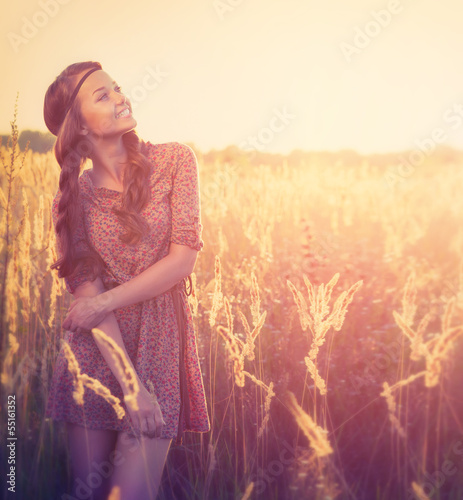 Beauty Girl Outdoor. Teenage Model Girl Posing in Sun Light