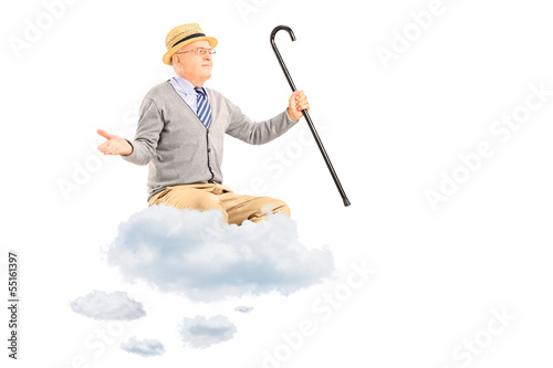 Happy senior man floating on a cloud and spreading arms