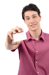 Man offering you a business card.Blured model, focused card.