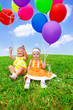 Toddlers playing with balloons