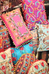 Fabrics, textiles and turkish rugs at a bazaar in Turkey