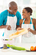 african couple preparing a salad