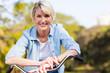 Leinwandbild Motiv senior woman on a bicycle