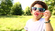 Kid cheerfully blowing soap bubbles