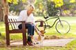 mature woman with pet dog outdoors - 55164138