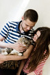 happy young couple at home with their cat