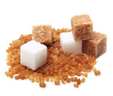 Brown and white cane sugar cubes isolated.