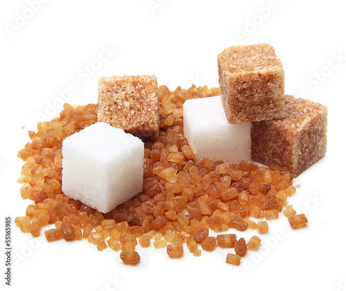 canvas print picture Brown and white cane sugar cubes isolated.