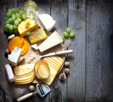 Fototapety Various types of cheese with empty space background concept