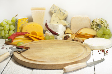 Many types of cheese on cutting board abstract composition