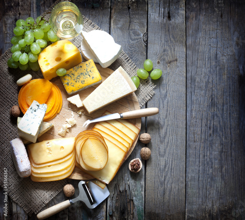 Deurstickers Assortiment Various types of cheese with empty space background concept