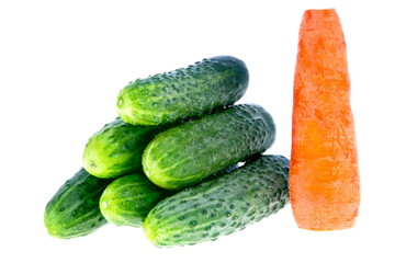 ripe cucumbers and carrots on a white background