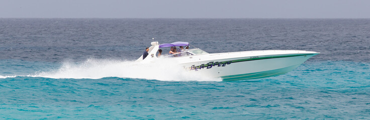 ST MARTIN - ANTILLES, JULY 19, 2013 - Speedboat with tourist on
