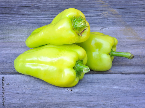 Fresh sweet green peppers on an old wooden table