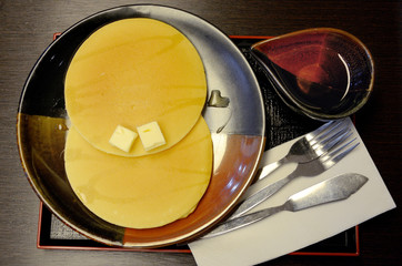 Pancake set with butter and honey