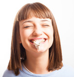 girl with exploted chewing gum on a white background