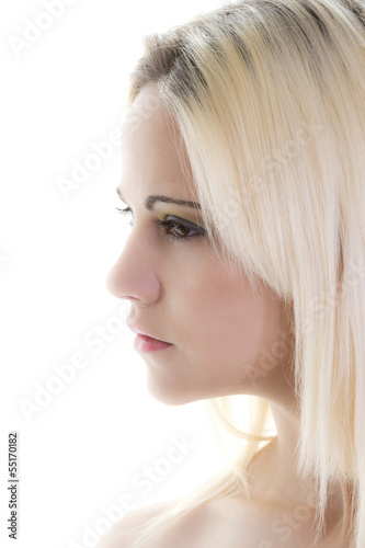 beautiful blond woman shot in profile isolated on white