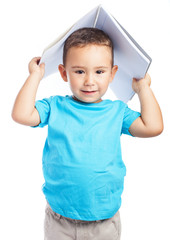 child playing with a notebook on white background