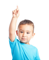 child pinting up with the finger on a white background