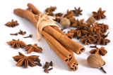 Cinnamon stick, anise, nutmeg and cloves on white background