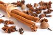 Cinnamon sticks, nutmeg, clove and anise on white background