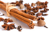 Cinnamon sticks, nutmeg, clove and anise on white background