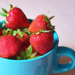 Fresh strawberries in a cup, healthy fruit snack