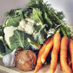 Fresh vegetables - onion, carrot, cauliflower and garlic