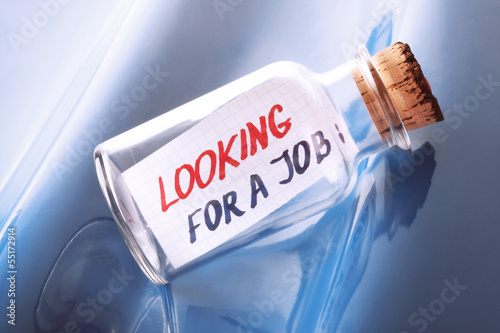 "concept of a bottle with a message ""Looking for a job"""