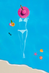 Top view of a woman silhouette with  beach items in the pool