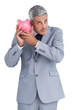 Doubtful businessman holding piggy bank