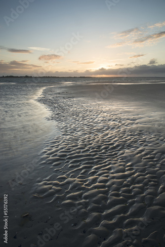 Beautiful landscape Summer sunset sky reflected on wet beach at