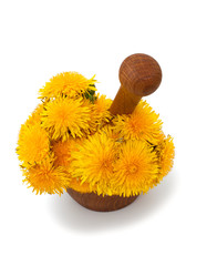 yellow dandelions in a mortar