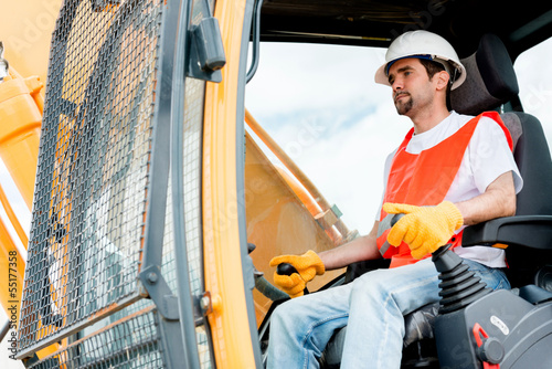 Construction worker operating a crane