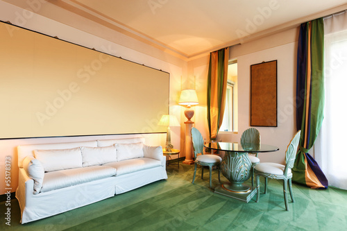 Interior luxury hotel, living room with white divan