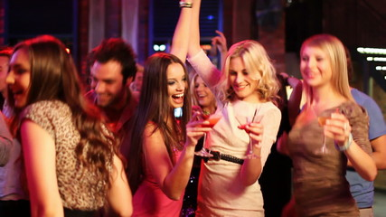 Dancing At A Party in nightclub, friends having drinks