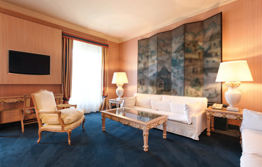 Interior luxury hotel, living room with white divan