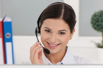 Customer service representative. Smiling young female customer s
