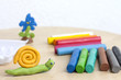 Plasticine on table with snail abstract background concept