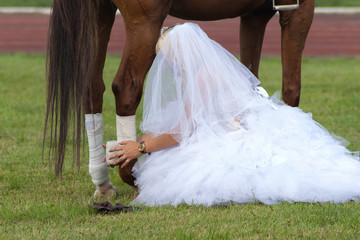 Horse and bride in wedding dress