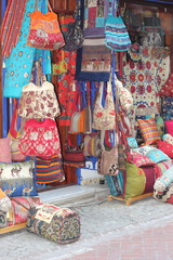 Fabrics, textiles,bags and turkish rugs at a bazaar in Turkey