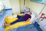 Man lying in hospital after arthroscopic surgery