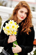 girl with daffodils